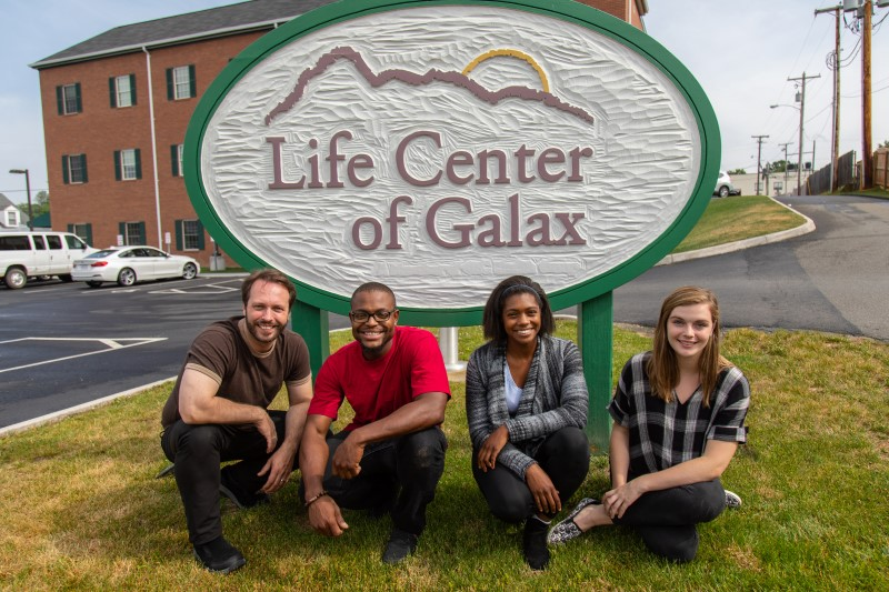 Clients pose in front of the entrance sign at Life Center of Galax