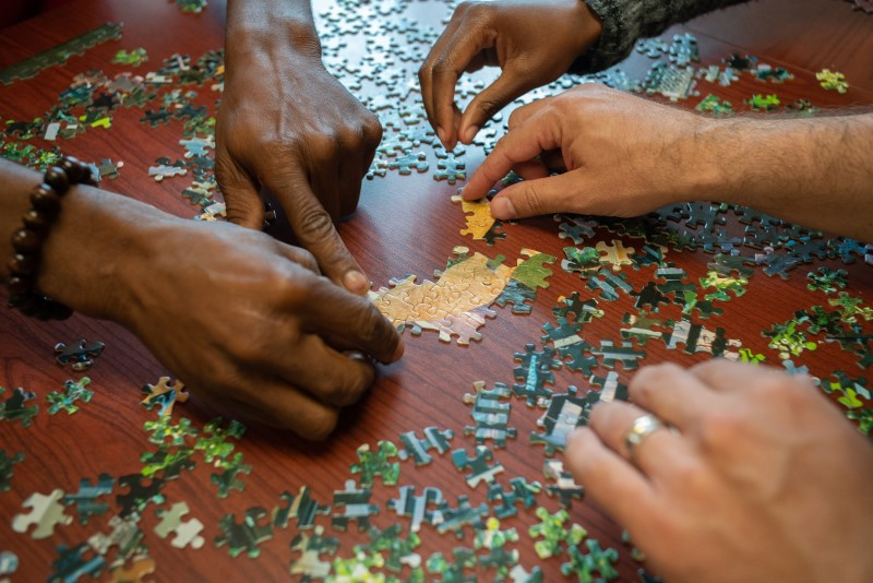 Clients work together on a puzzle at Life Center of Galax